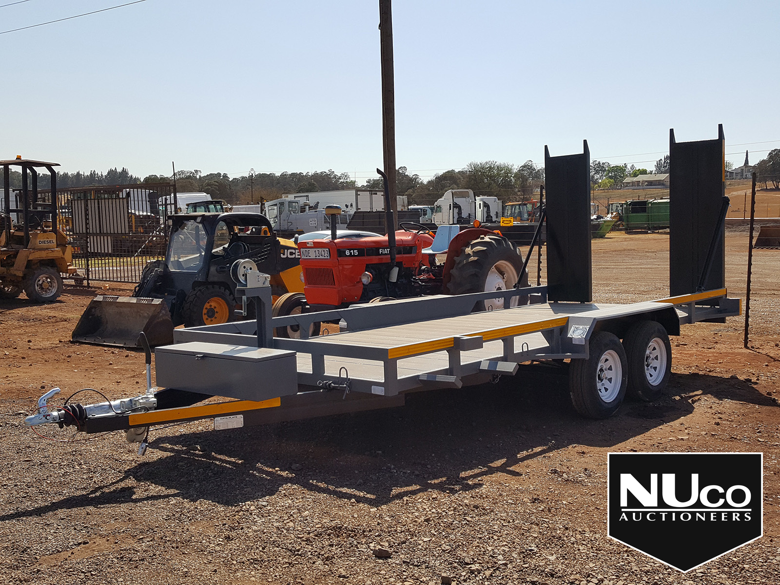 DOUBLE AXLE CAR CARRIER TRAILER WITH RAMPS | Nuco Auctioneers